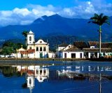 AT7F1K Parati town and building exteriors reflected in water Brazil